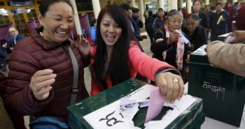Tibetan exiles react as they cast their vote during the elections for the Tibetan government-in-exile at a polling booth in Dharamsala, India, March 20, 2016. (Reuters)